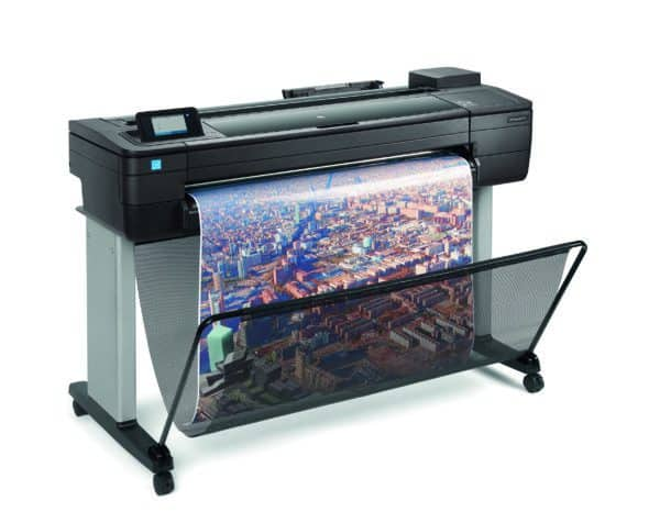 HP DesignJet T730 - photo shows the printer with a printout dropping into the media basket below, giving an impression of the size of printer and the capability and typical user output