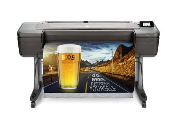 HP DesignJet Z6ps 44-in A0 printer - photo shows the printer with a printout dropping into the media basket and gives an impression of the size of the printer and the capability and typical user output