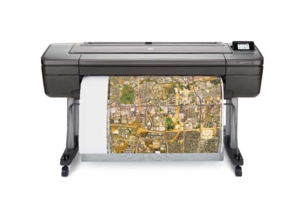 HP DesignJet Z6ps 44-in A0 printer - photo shows the printer with a printout being trimmed vertically and gives an impression of the size of the printer and the capability and typical user output